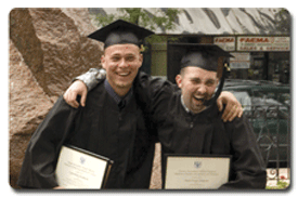 picture of two students celebrating at graducation
