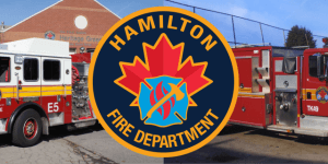 Two fire trucks with Hamilton Fire Department logo