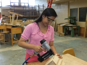 Girl working on a wooden project