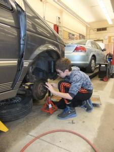 Student checking brakes