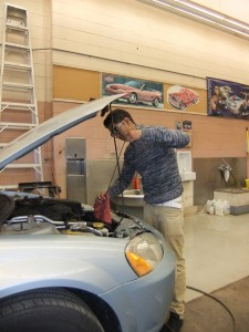 Student checking engine oil