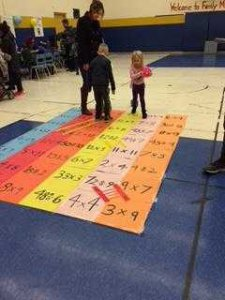 Playing with math puzzles on the floor