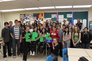 Students holding EPIC logo