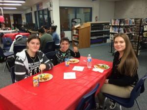 Three kids at a table