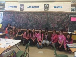 Eleven Students sitting for day of pink