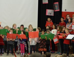 Kids singing with orange and green book