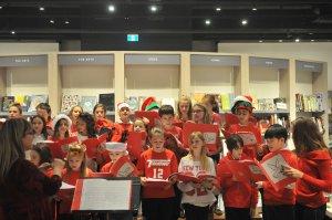 Kids in red singing