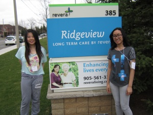 Students in front of a Rideview sign