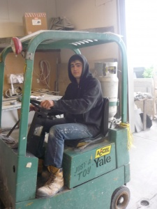 Student on a forklift