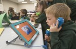 Gary Yokoyama,The Hamilton Spectator Five-year-old Jack Schurer, an SK student at Bellmoore School in Binbrook, listens to a classmate's project that integrates learning with the use of tablets.