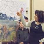 Students display art at Experiential Learning Day in the Arts.