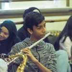 Students play music in Experiential Learning Day in the Arts.
