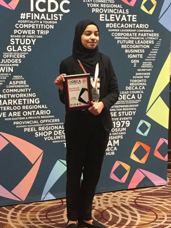 Fatima Zakar accepts her Provincial Champion award from DECA